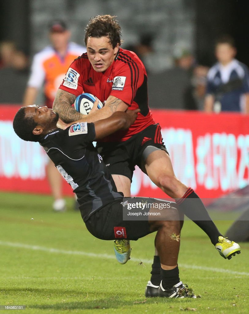 Zac Guildford of the Crusaders with the ball in the tackle of Sergeal Petersen of the Kings during the round six Super Rugby match between the Crusaders and the Kings at AMI Stadium on March 23, 2013 in Christchurch, New Zealand.