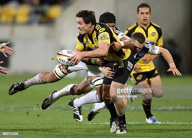 Zac Guildford of the Hurricanes is tackled by Peter Saili and Jimmy Gopperth of the Blues during the round 12 Super 14 match between the Hurricanes...