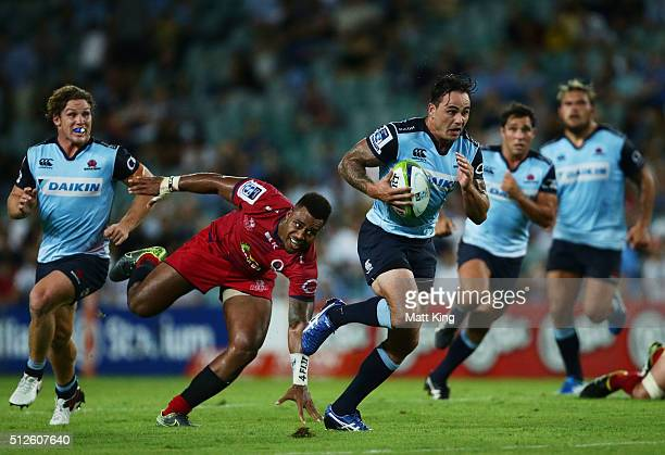 Zac Guildford of the Waratahs makes a break during the round one Super Rugby match between the Waratahs and the Reds at Allianz Stadium on February...