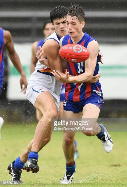 Zac Hart of Oakleigh is tackled during the round one TAC Cup match between Oakleigh and Eastern at Frankston Oval on March 24 2018 in Melbourne...