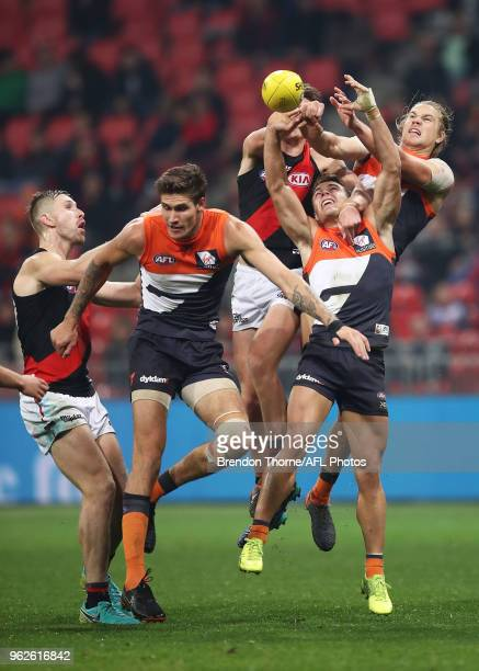 Zac Langdon of the Giants attempts to grab a mark with the pack during the round 10 AFL match between the Greater Western Sydney Giants and the...