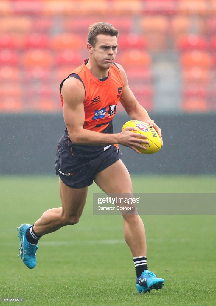 Zac Langdon of the Giants runs the ball during a Greater Western Sydney Giants AFL training session at Spotless Stadium on June 27, 2018 in Sydney, Australia.