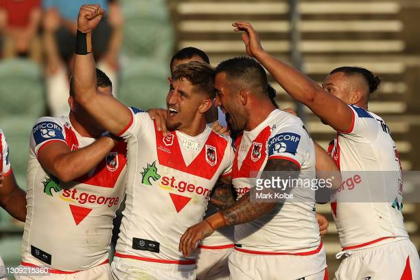 Zac Lomax of the Dragons celebrates with team mates after scoring a try during the round three NRL match between the St George Illawarra Dragons and...