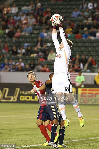 Zac MacMath of Philadelphia Union protects the net against Erick Torres of Chivas USA in the second half at StubHub Center on May 31 2014 in Los...