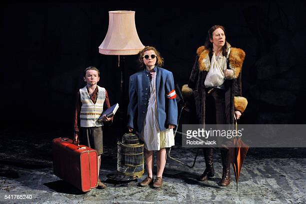 Zac McCullough as the boy Rebecca Benson as the girl and Catherine Walsh as Beatriz in the National Theatre of Scotland's production of Zinnie...