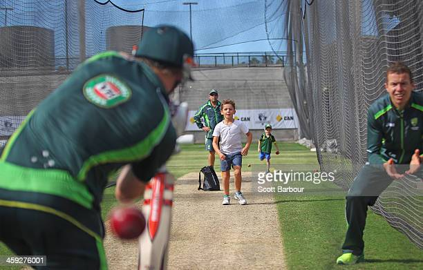 Zac McDermott son of Australian bowling coach Craig McDermott bowls to George Bailey of Australia as Darren Lehmann coach of Australia Peter Siddle...