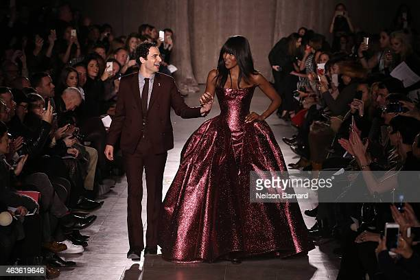 Zac Posen and Noami Campbell walk the runway at the Zac Posen fashion show during Mercedes-Benz Fashion Week Fall 2015 at Vanderbilt Hall at Grand...