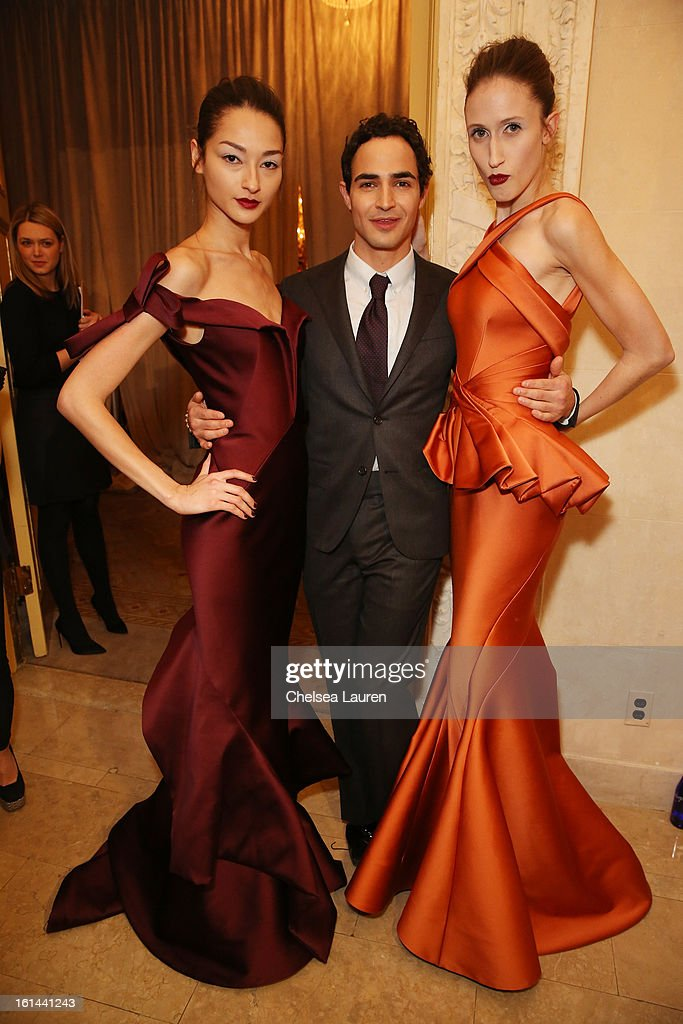 Zac Posen poses with models backstage before the Zac Posen Fall 2013 fashion show during Mercedes-Benz Fashion Week on February 10, 2013 in New York City.