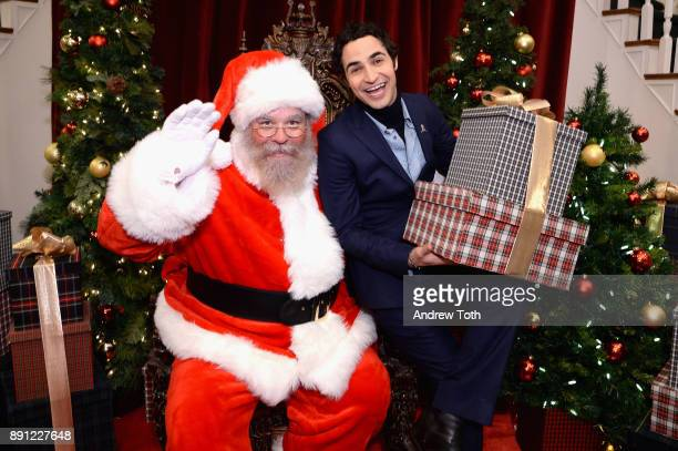 Zac Posen poses with Santa as Brooks Brothers celebrates the holidays with St Jude Children's Research Hospital on December 12 2017 in New York City