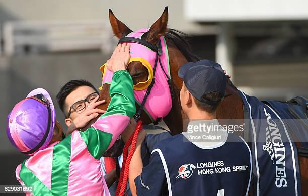 Zac Purton gives Aerovelocity a pat after winning Race 5 the Longines Hong Kong Sprint during Hong Kong International Racing at Sha Tin Racecourse on...