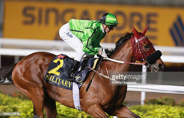 Zac Purton rides Military Attack to win the Group 1 Singapore Airlines International Cup during Singapore racing at the Singapore Turf Club on May 19...