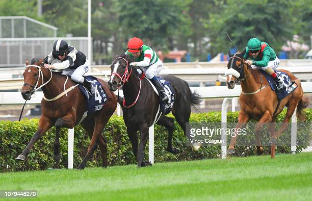 Zac Purton riding Exultant defeats Joao Moreira riding Lys Gracieux and Christophe Lemaire riding Eziyra in Race 4 Longines Hong Kong Vase during the...