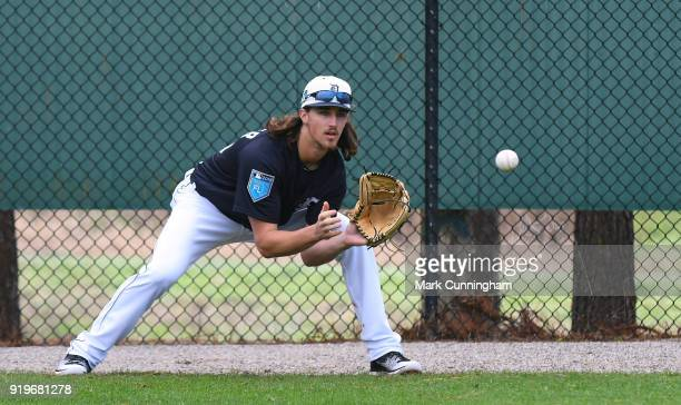 Zac Reininger of the Detroit Tigers catches a baseball during Spring Training workouts at the TigerTown Facility on February 17 2018 in Lakeland...
