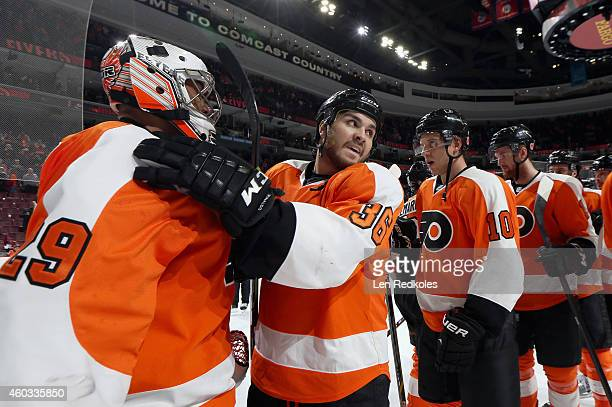 Zac Rinaldo and Ray Emery of the Philadelphia Flyers celebrate with their teammates after defeating the New Jersey Devils 41 on December 11 2014 at...