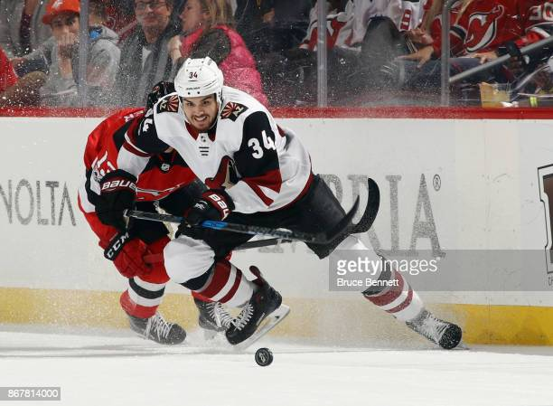 Zac Rinaldo of the Arizona Coyotes skates against the New Jersey Devils at the Prudential Center on October 28 2017 in Newark New Jersey The Devils...
