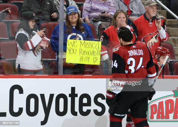 Zac Rinaldo of the Arizona Coyotes skates past a fan holding a sign direct at him prior to a game against the San Jose Sharks at Gila River Arena on...