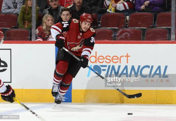 Zac Rinaldo of the Arizona Coyotes skates with the puck against the New York Islanders at Gila River Arena on January 22 2018 in Glendale Arizona