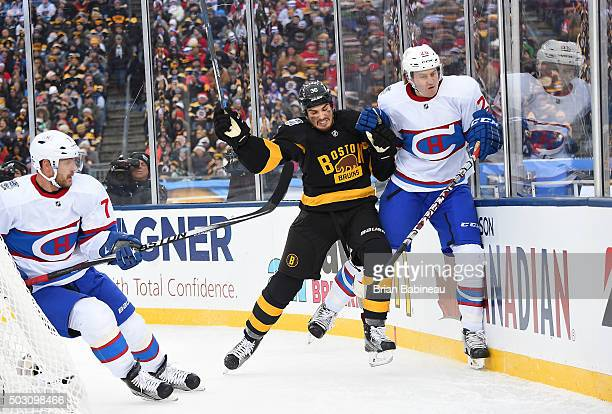 Zac Rinaldo of the Boston Bruins checks Jeff Petry of the Montreal Canadiens at the end boards in the first period during the 2016 Bridgestone NHL...