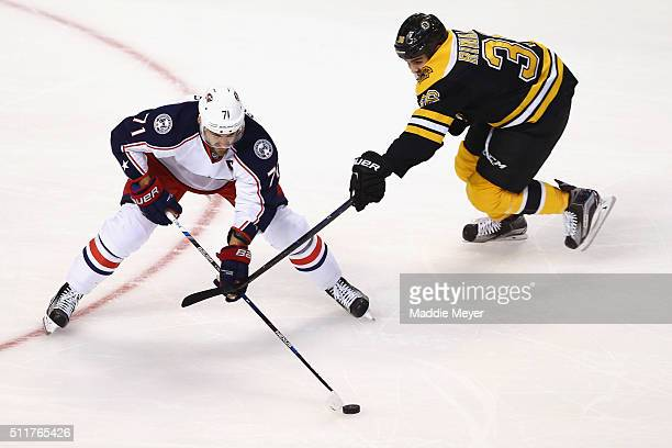 Zac Rinaldo of the Boston Bruins defends Nick Foligno of the Columbus Blue Jackets during the first peirod at TD Garden on February 22 2016 in Boston...