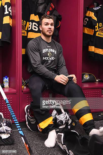 Zac Rinaldo of the Boston Bruins puts on his pads in the locker room prior to the 2016 Bridgestone NHL Classic against the Montreal Canadiens at...