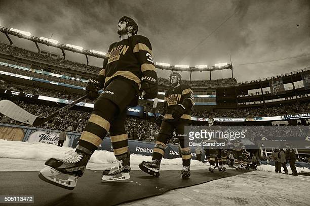 Zac Rinaldo of the Boston Bruins walks on to the field before the third period of the 2016 Bridgestone NHL Classic against the Montreal Canadiens at...
