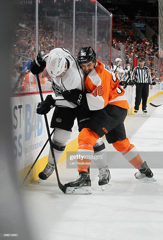 Zac Rinaldo #36 of the Philadelphia Flyers battles for position with Jake Muzzin #6 of the Los Angeles Kings on October 28, 2014 at the Wells Fargo Center in Philadelphia, Pennsylvania. The Flyers defeated the Kings 3-2 in overtime.