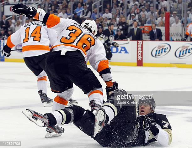Zac Rinaldo of the Philadelphia Flyers check Evgeni Malkin of the Pittsburgh Penguins in Game Two of the Eastern Conference Quarterfinals during the...