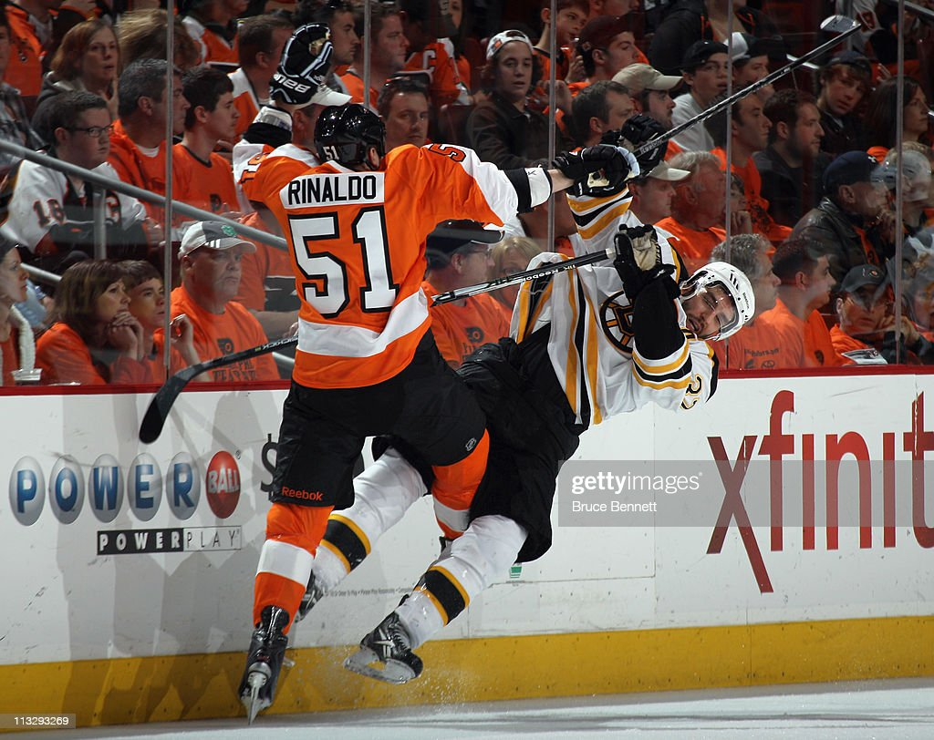 Zac Rinaldo #51 of the Philadelphia Flyers hits Patrice Bergeron #37 of the Boston Bruins in Game One of the Eastern Conference Semifinals during the 2011 NHL Stanley Cup Playoffs at the Wells Fargo Center on April 30, 2011 in Philadelphia, Pennsylvania.The Bruins defeated the Flyers 7-3.