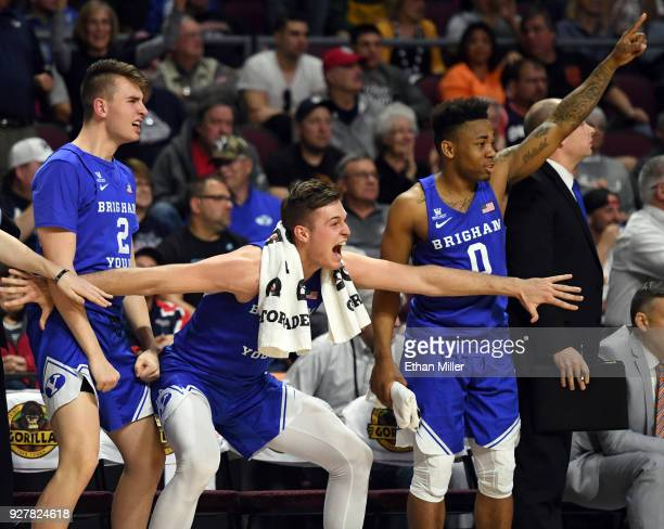 Zac Seljaas, Luke Worthington and Jahshire Hardnett react on the bench after teammate Dalton Nixon dunked against the Saint Mary's Gaels during a...