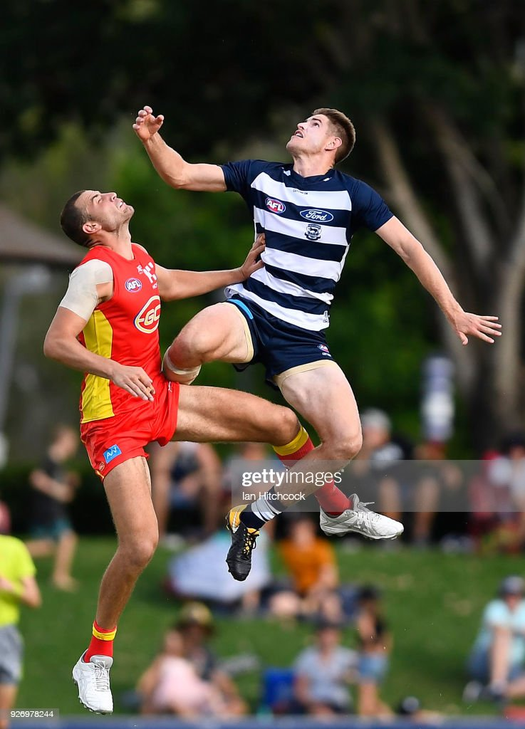 Zac Smith of the Cats and Jarrod Witts of the Suns contest the ball during the AFL JLT Community Series match between the Geelong Cats and the Gold Coast Suns at Riverway Stadium on March 4, 2018 in Townsville, Australia.