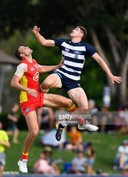 Zac Smith of the Cats and Jarrod Witts of the Suns contest the ball during the AFL JLT Community Series match between the Geelong Cats and the Gold...