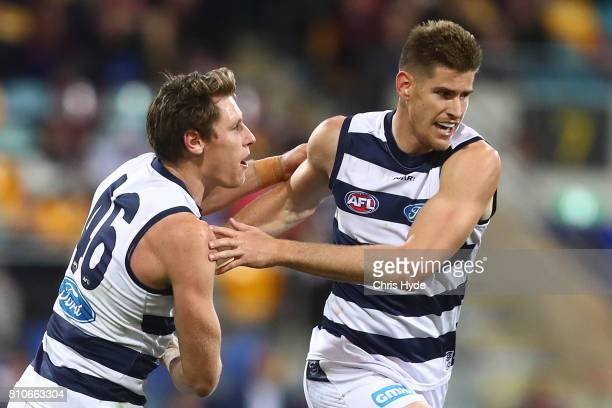 Zac Smith of the Cats celebrates a goal during the round 16 AFL match between the Brisbane Lions and the Geelong Cats at The Gabba on July 8 2017 in...