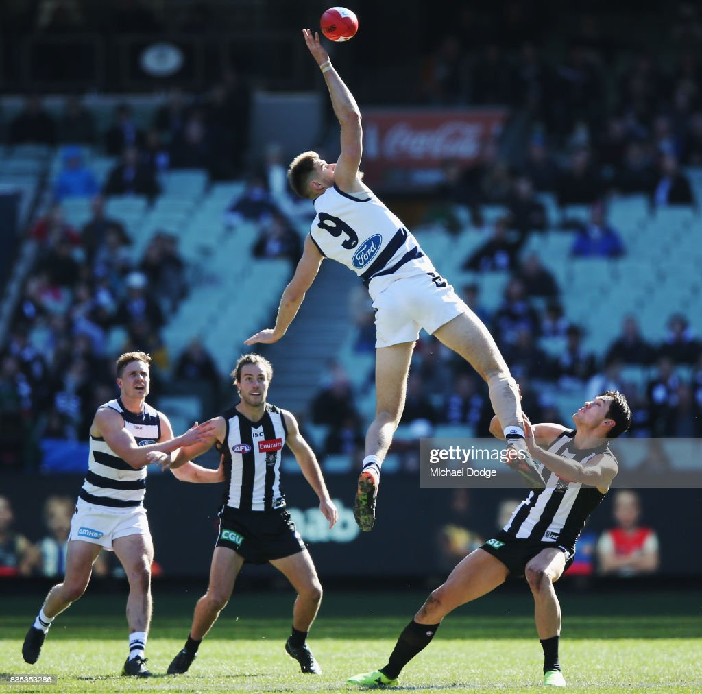 Zac Smith of the Cats rucks over Darcy Moore of the Magpies during the round 22 AFL match between the Collingwood Magpies and the Geelong Cats at Melbourne Cricket Ground on August 19, 2017 in Melbourne, Australia.