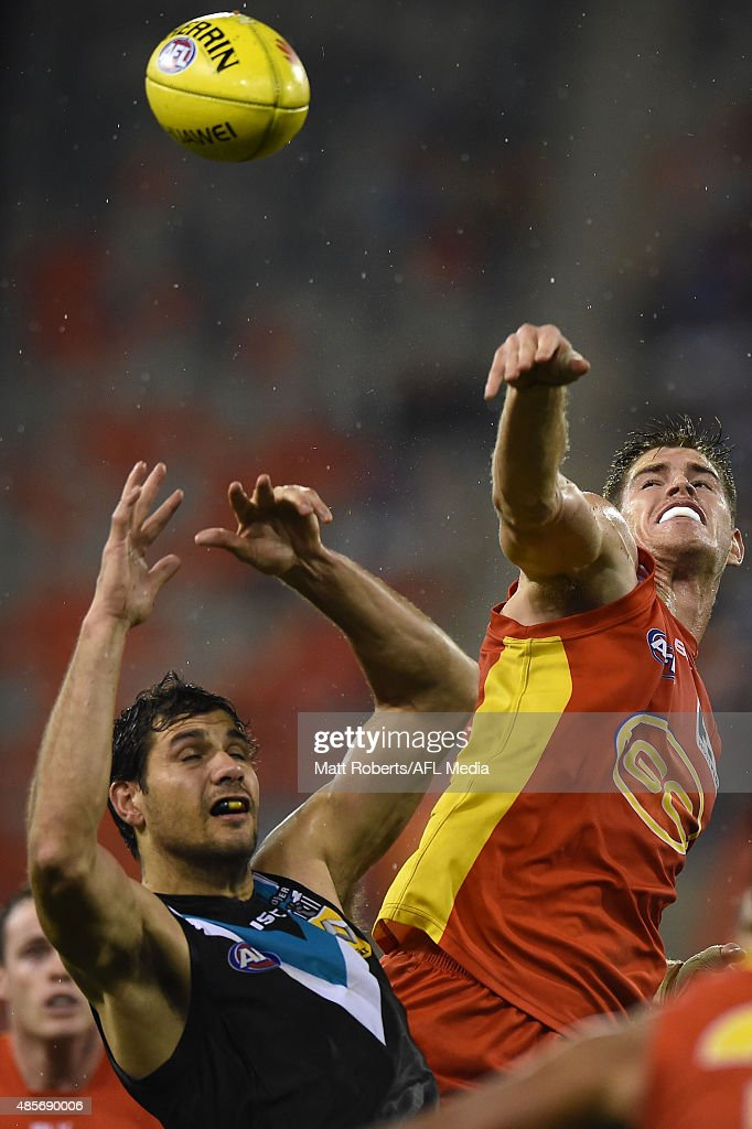 Zac Smith of the Suns competes for the ball during the round 22 AFL match between the Gold Coast Suns and the Port Adelaide Power at Metricon Stadium on August 29, 2015 on the Gold Coast, Australia.