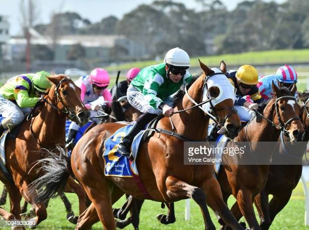 Zac Spain riding Holy Command wins Race 4 during Ladbrokes Park Race Day at Sandown Hillside on July 25 2018 in Melbourne Australia
