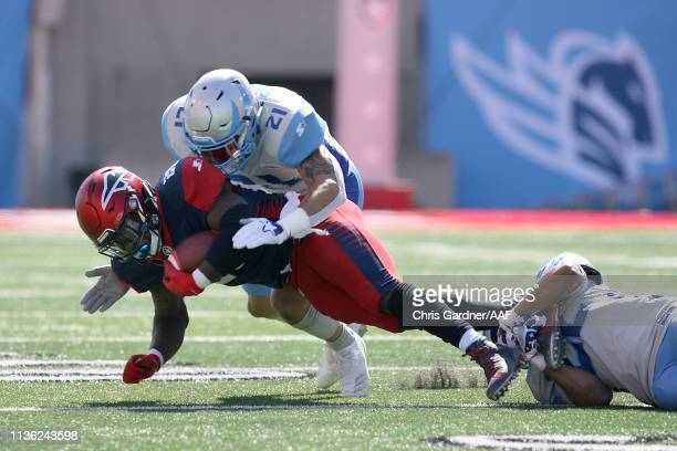 Zac Stacy of the Memphis Express is tackled by Cody Brown of the Salt Lake Stallions in the first half at Rice Eccles Stadium on March 16 2019 in...