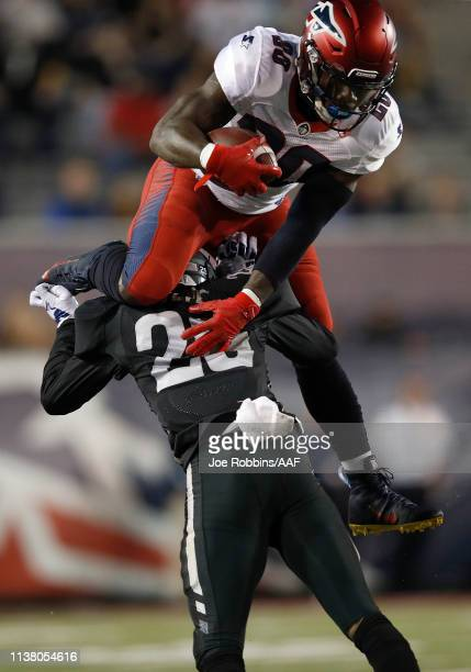Zac Stacy of the Memphis Express leaps over Bradley Sylve of the Birmingham Iron during the first half of their Alliance of American Football game at...