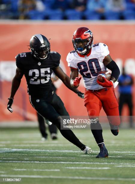 Zac Stacy of the Memphis Express runs the ball against Jack Tocho of the Birmingham Iron during the first quarter of their Alliance of American...