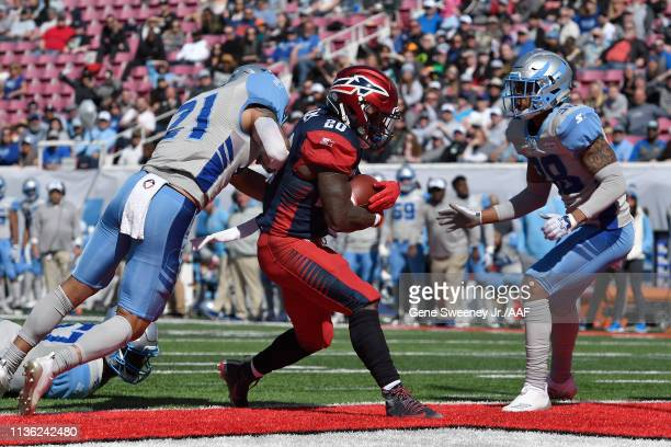 Zac Stacy of the Memphis Express scores a touchdown against Cody Brown and Henre' Toliver of the Salt Lake Stallions in the second quarter at Rice...