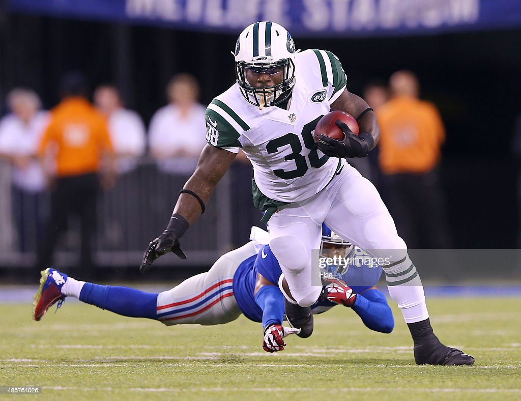 Zac Stacy #38 of the New York Jets carries the ball as Trumaine McBride #38 of the New York Giants during preseason action at MetLife Stadium on August 29, 2015 in East Rutherford, New Jersey.