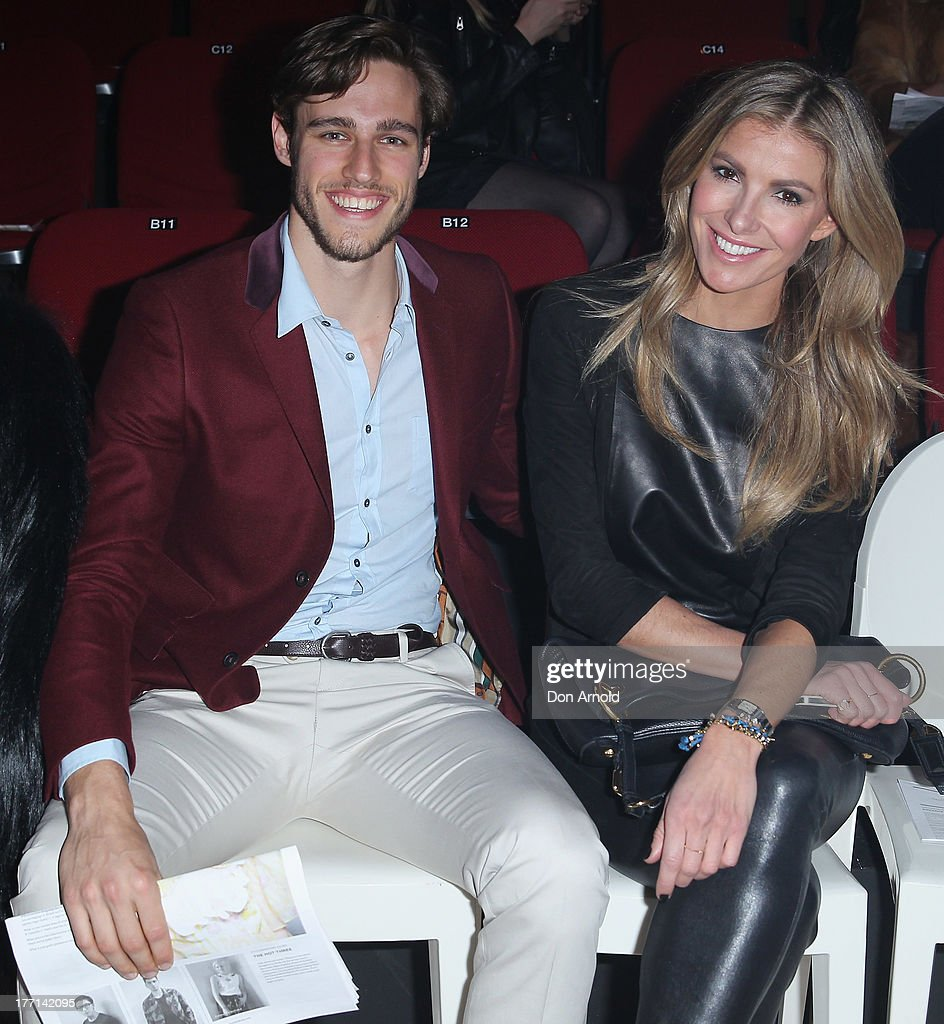 Zac Stenmark and Laura Csortan watch the MBFWA Trends show during Mercedes-Benz Fashion Festival Sydney 2013 at Sydney Town Hall on August 21, 2013 in Sydney, Australia.