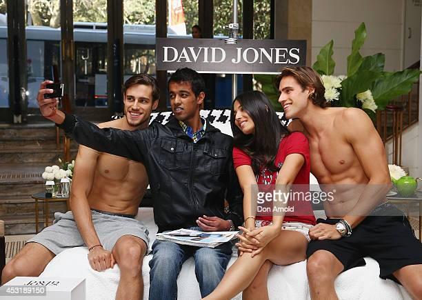 Zac Stenmark, Jessica Gomes and Jordan Stenmark have a 'selfie' taken with a customer at David Jones Elizabeth Street Store on August 5, 2014 in...