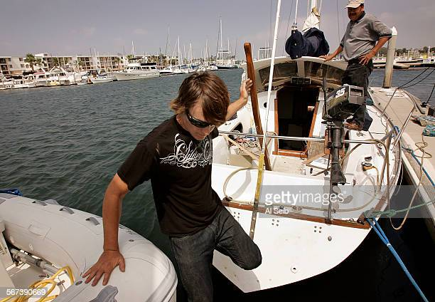 Zac Sunderland aboard his 36foot boat the Intrepid docked in Marina del Rey is busy locating items before attempting to climb the main mast in a...