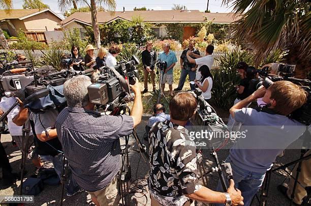 Zac Sunderland left Jeff Casher who provides technical support for Abby's team and Pastor Joe Schimmel talk to media in front of the Sunderland...