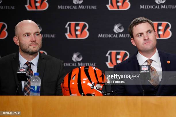 Zac Taylor looks on along with Cincinnati Bengals director of player personnel Duke Tobin after being introduced as the new head coach for the...