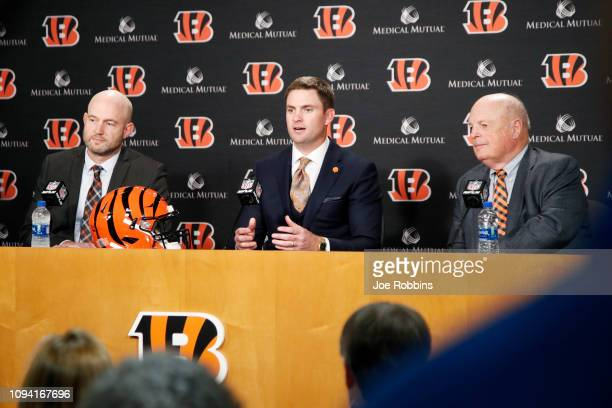 Zac Taylor speaks to the media as Cincinnati Bengals director of player personnel Duke Tobin and owner Mike Brown look on after being introduced as...