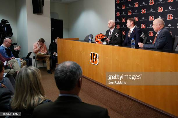 Zac Taylor speaks to the media as director of player personnel Duke Tobin and owner Mike Brown look on after being introduced as the new head coach...