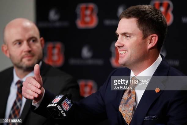 Zac Taylor speaks to the media as director of player personnel Duke Tobin looks on after being introduced as the new head coach for the Cincinnati...