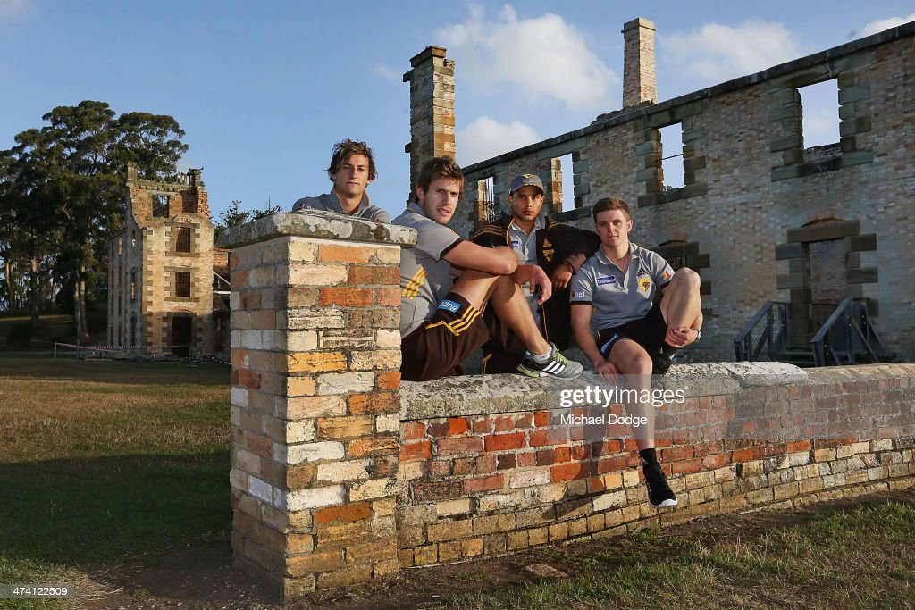 Zac Webster, Grant Birchall, Dayle Garlett and Taylor Duryea pose at the historic Port Arthur site during the Hawthorn Hawks AFL Community Camp on February 22, 2014 in Port Arthur, Australia.