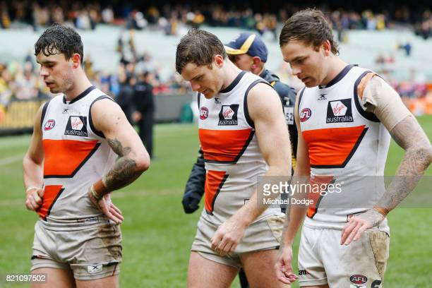Zac Williams Heath Shaw and Nathan Wilson of the Giants look dejected after defeat during the round 18 AFL match between the Richmond Tigers and the...